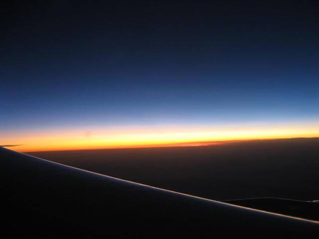 Sonnenaufgang auf dem Flug nach Shanghai, China.